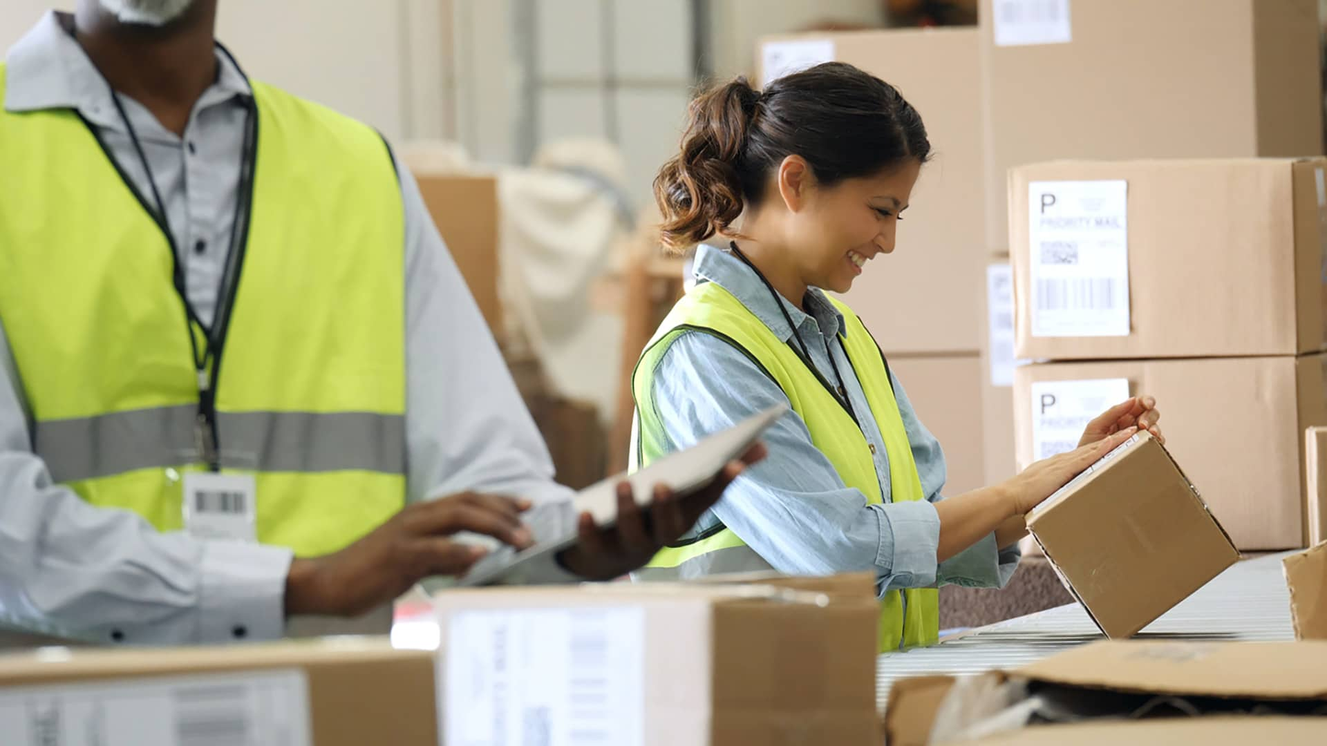 warehouse staff working with packages