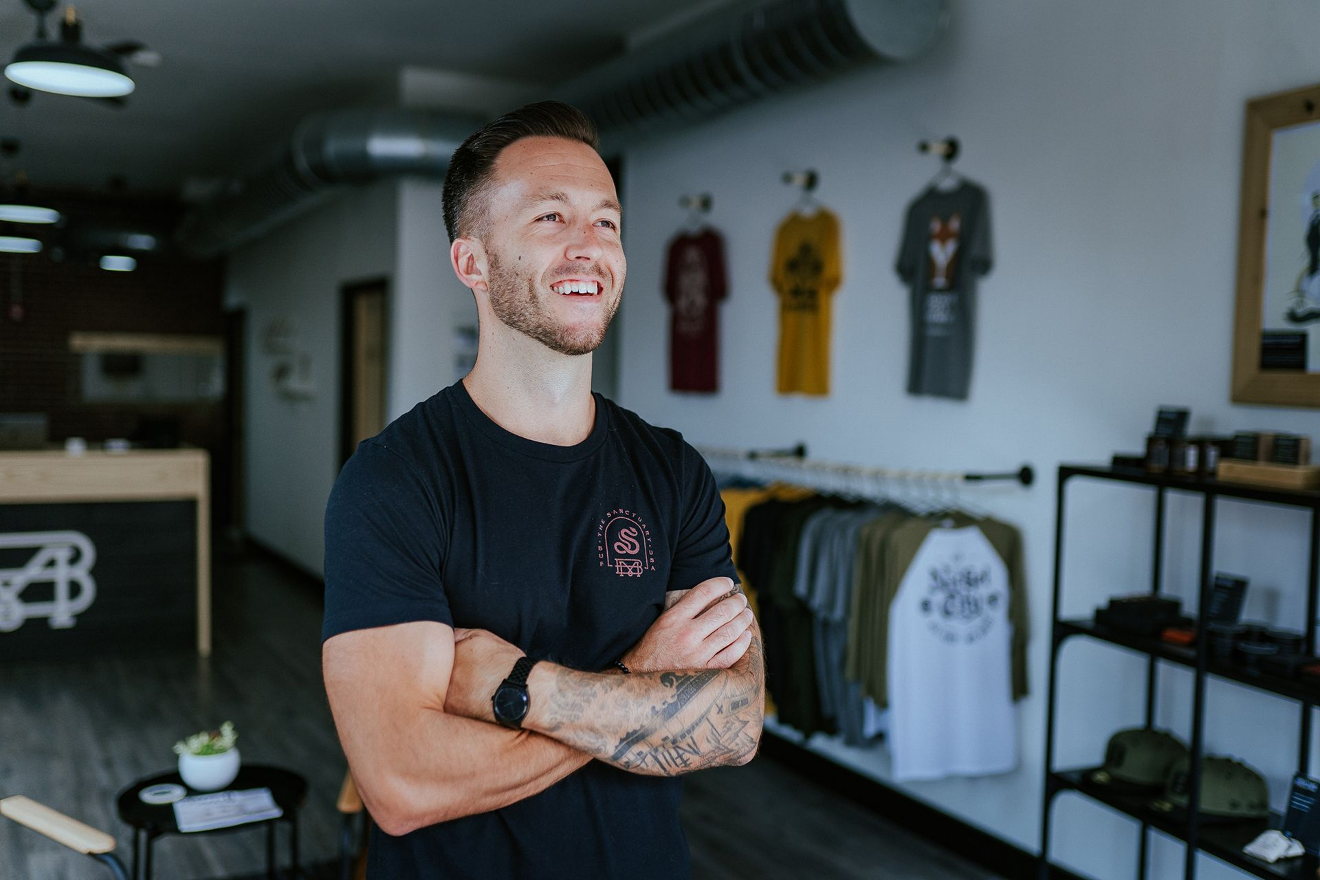 Buffalo Made Co owner, Rob smiling with arms folded at the front of his retail store